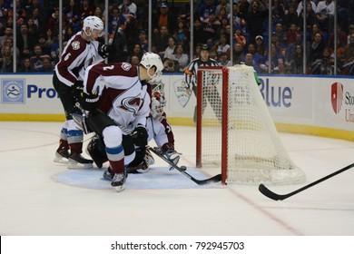 UNIONDALE, NEW YORK, UNITED STATES – FEB 8, 2014: NHL Hockey: Jean-Sebastien Giguere (Colorado Avalanche) during game vs. New York Islanders at Nassau Coliseum. Erik Johnson #6. Nick Holden #2.