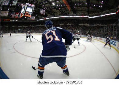 UNIONDALE, NEW YORK, UNITED STATES – FEB 8, 2014: NHL Hockey: Fish-eye view. Frans Nielsen, of the New York Islanders, in a game between the Islanders and Colorado Avalanche at Nassau Coliseum.