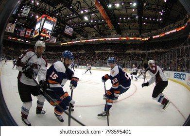 UNIONDALE, NEW YORK, UNITED STATES – FEB 8, 2014: NHL Hockey: Fish-eye view of game action between the New York Islanders and Colorado Avalanche at Nassau Coliseum. Cal Clutterbuck, 15 Brock Nelson 29