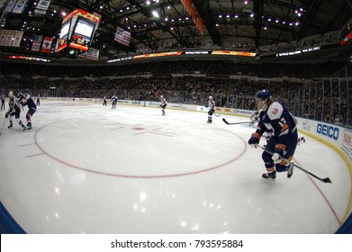 UNIONDALE, NEW YORK, UNITED STATES – FEB 8, 2014: NHL Hockey: Fish-eye view. Matt Martin, of the New York Islanders, in a game between the Islanders and Colorado Avalanche at Nassau Coliseum.