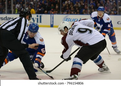 UNIONDALE, NEW YORK, UNITED STATES – FEB 8, 2014: NHL Hockey: Casey Cizikas (New York Islanders) and Matt Duchene (Colorado Avalanche) during a face-off at Nassau Veterans Memorial Coliseum.