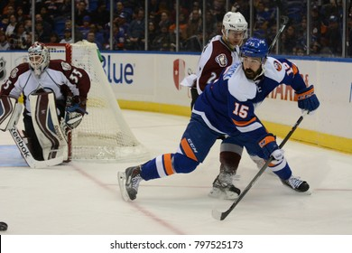 UNIONDALE, NEW YORK, UNITED STATES – FEB 8, 2014: NHL Hockey: Cal Clutterbuck, of the New York Islanders during a game against the Colorado Avalanche at Nassau Veterans Memorial Coliseum.