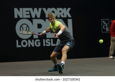 Uniondale, NY - February 17, 2018: Kevin Anderson of South Africa returns ball during semifinal match against Kei Nishikori of Japan at ATP 250 New York Open at Nassau Coliseum