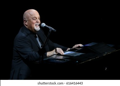 UNIONDALE, NY-APR 5: Musician Billy Joel performs in concert at the newly renovated NYCB Live, Home of the Nassau Veterans Memorial Coliseum on April 5, 2017 in Uniondale, New York.