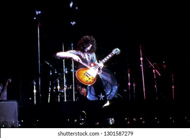 Uniondale, NY/USA - February 13, 1975: Legendary guitarist Jimmy Page of Led Zeppelin bows his guitar during the band's performance at Nassau Coliseum on their 1975 North American tour.