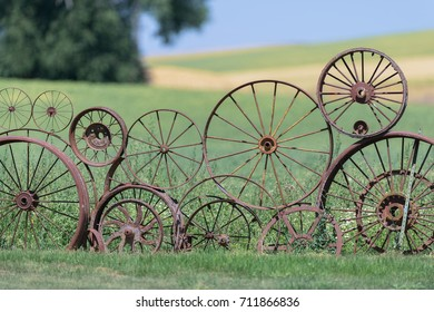 UNIONTOWN, WASHINGTON - JULY 25: Wagon wheel fence at the Artisans at the Dahmen Barn on July 25, 2017 in Uniontown, Washington