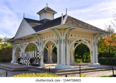 Unionville, Markham, Canada - October 6, 2019: Big sign of Unionville in front of Millennium Bandstand along Main Street.