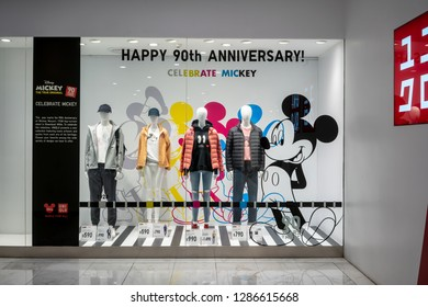 Uniqlo at Emquatier, Bangkok, Thailand, Dec 25, 2018 : Luxury and fashionable brand window display. Winter collection of casual wear display at flagship store.  90th Anniversary celebrate Mickey