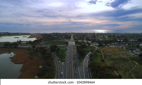 Unique aerial view of the ocean and freeway merger between the 5 and the 78 in Oceanside and Carlsbad in north county San Diego Southern California