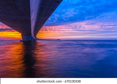 Unique angle of the Garcon Point Bridge spanning over Pensacola Bay shot during a gorgeous sunset from the Gulf Breeze, Florida side of the bridge