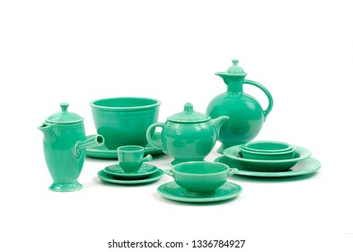 Unique Assortment of Original Green Glaze Vintage Antique Fiesta Pottery and Tableware. Saucers, Plates, Demitasse Cup, Mixing Bowl, Tea pot, Demitasse Coffee Carafe and Water Pitcher