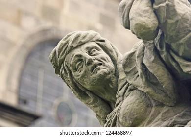 Unique baroque sandstone statue depicting avarice. Statue created in 1715 Matyas Bernard Braun (State castle Kuks  Czech Republic, Central Europe)