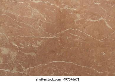 Unique beige-pink, almost terracotta marble Rosso Antico produced in Italy. The old noble stone comes from antiquity. Natural stone for interior decoration.