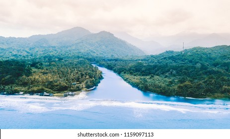 A unique coastal setting of the Sierra Nevada of Santa Marta on the Caribbean Coast  of Colombia. An aerial of the freshwater river meeting the sea.