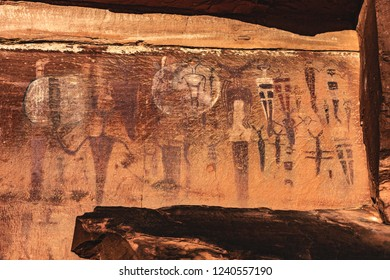 Unique and colorful anthropomorphs (ancient aliens?) on the Courthouse Wash pictograph panel, a collection of rock art on the outskirts of Arches National Park near Moab, Utah, USA.