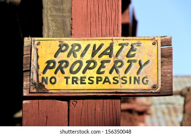 Unique, colorful, weathered and worn vintage private property sign.