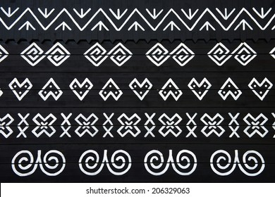 Unique decoration of log houses based on patterns used in traditional embroidery in village of Cicmany, UNESCO World Heritage Site, Slovakia