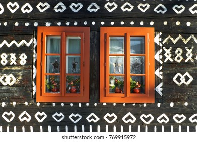 Unique decoration of log houses based on patterns used in traditional embroidery in village of Cicmany village, Slovakia