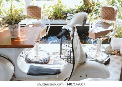 unique exterior design for lounge or terrace using classic motorcycle as a modification table and classic bar stool chair using tire and shockbreaker, vintage design.Jakarta, August 21st, 2019