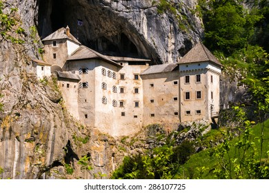 The unique and famous Predjama Castle in Slovenia. The renaissance castle was built within a cave mouth to offer best protection.