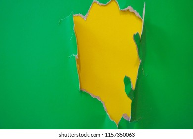 Unique flat lay background with color fragmentary paper. Green and yellow.