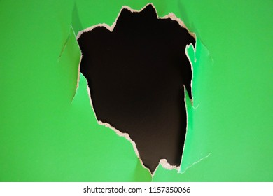 Unique flat lay background with color fragmentary paper. Green and black.