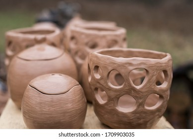 Unique handmade pots and dishes of clay before firing and reducing process in wood fire kiln. Black pottery is one of the traditional craftsmanship in Latvia