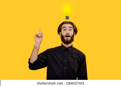 Unique idea. Bright idea and insight concept with light bulb, Isolated on yellow background, creative idea and  yellow background, Positive emotion facial expression feeling, attitude, perception
