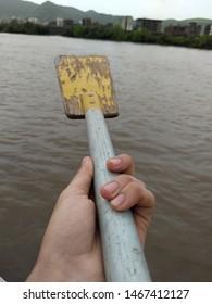 A unique image of an oar of a boat in sea.