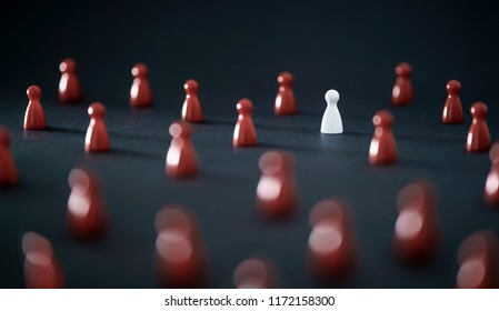 Unique individual standing out in crowd. Leadership, uniqueness and winning competitors. Originality, independence, difference or loneliness concept. One different color board game pawn.