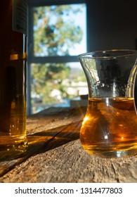 Unique Irish Whiskey Glass And Irish Whiskey Bottle with Sunny Irish Window Behind