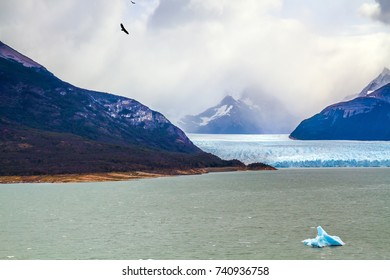 Unique lake and glacier Perito Moreno,  in a mountain valley. Argentine Province of Santa Cruz, Patagonia. The concept of  exotic and extreme tourism