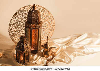 "unique lantern with ""dallah"" Arabian coffee  on satin texture background"