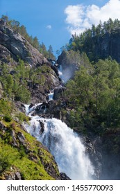 Unique Latefoss (Latefossen) waterfall with two joining streams on Norwegian National Road 13, a popular tourist attraction in Odda, Hordaland county, Norway, Scandinavia