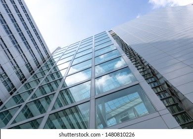 Unique low angle building perspective. bright sun reflecting on the glass of the modern building. shot in the netherlands.
