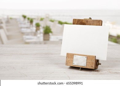 Unique mockup menu frame on table over blurred restaurant interior