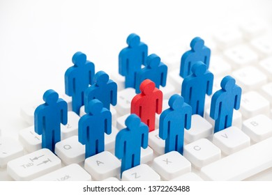Unique person in the crowd on computer keyboard