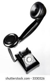 Unique perspective of retro phone on white background