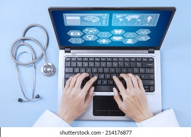 Unique Perspectives of male doctor working on a laptop
