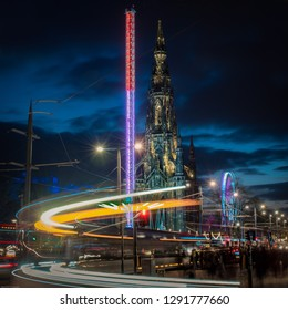 a unique photograph of the Scott monument at night, the orange light trail was a result of perfectly timing a long exposure whilst a tram was passing by.