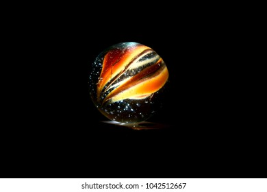 Unique playing marble balls isolated object with dark background photo