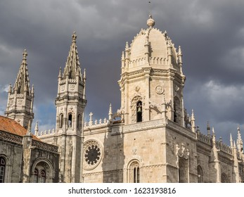 Unique Portuguese architecture. Ornate Late Gothic or Manueline style carvings of towers, of Jerónimos or Hieronymites Monastery and Catholic church Igreja Santa Maria de Belém in Lisbon, Portugal.