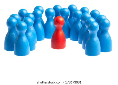 Unique red pawn centered in the middle of a large group. Concept for mobbing, autism, diversity, being different. Cutout, isolated on white.