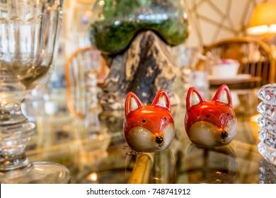 Unique salt shakers on a table.