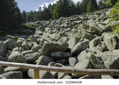Unique stone river big granite stones on rocky river with wooden bridge in the Vitosha National Park Mountain , Bulgaria