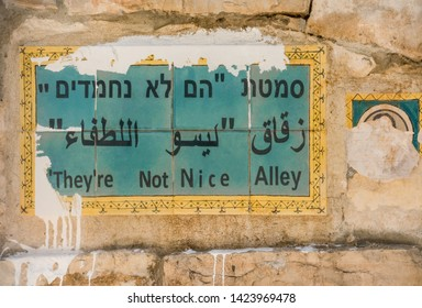 Unique street name sign on a wall in Jerusalem, social issue, social protest