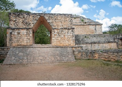 A unique triangular arch entry gate stands sentry behind the defensive walls surrounding Ek' Balam temple site