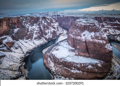 A unique view of Horseshoe Bend covered in a dusting of snow.