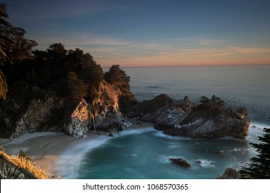 Unique view at Mc Way waterfall in Julia Pfeiffer Burns State Park at sunrise