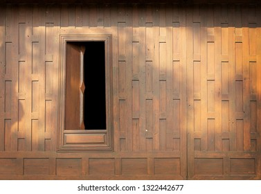 unique wood architecture of old Thai exterior with window and wall of vintage Thai house decoration with copy space for retro background